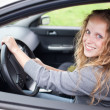 Pretty young woman driving her new car — Stock Photo #7417837