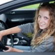Royalty-Free Stock Photo: Pretty young woman driving her new car