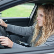 Pretty young woman driving her new car — Stock Photo #7417882