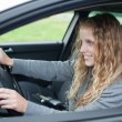 Pretty young woman driving her new car — Stock Photo #7417886