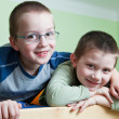 Royalty-Free Stock Photo: Two little brothers happy together (shallow DOF; color toned ima