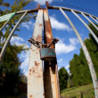 Gate with padlock on a lovely autumn day(intentionally distorter - Stok fotoğraf