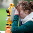 Young land surveyor at work — Stock Photo