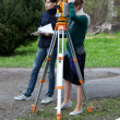 Young land surveyor at work - Foto de Stock