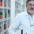 Renowned scientist/doctor in a library of research center/hospit — Stock Photo