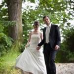 Lovely young wedding couple - freshly wed groom and bride posing — Stock Photo #7419106