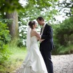 Lovely young wedding couple - freshly wed groom and bride posing — Stock Photo #7419113