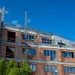 Residential building construction site on a lovely summer day (c - Foto Stock
