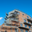 Stock Photo: Residential building construction site on a lovely summer day (c