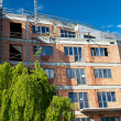 Residential building construction site on a lovely summer day (c — Stock Photo
