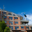 Residential building construction site on a lovely summer day (c — Stock Photo #7419377