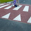 Father with a small girl on a bike crossing a street (motion bl — Stock Photo #7419568