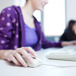 Pretty young college student in a library (shallow DOF; color to — Stock Photo #7419815
