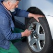 Royalty-Free Stock Photo: Mechanic changing a wheel of a modern car