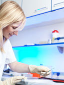 Portrait of a female researcher working in a lab — Stock Photo