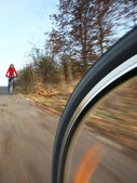 Biking (the image is motion blurred to convey movement; focus i — Stock Photo