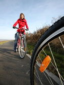 Biking (the image is motion blurred to convey movement; focus is — Stock Photo