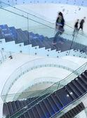 Inside a modern building (color toned image; motion blurr — Stock fotografie