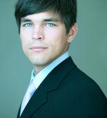 Close-up portrait of a young handsome confident businessman — Stock Photo
