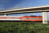 Fast train passing under a bridge — Stock Photo