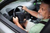 Handsome senior man driving a car — Stock Photo