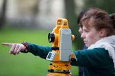 Young land surveyor at work — Stock Photo