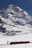 Swiss Alps (Jungfraujoch with its tiny cog train) — Stock Photo