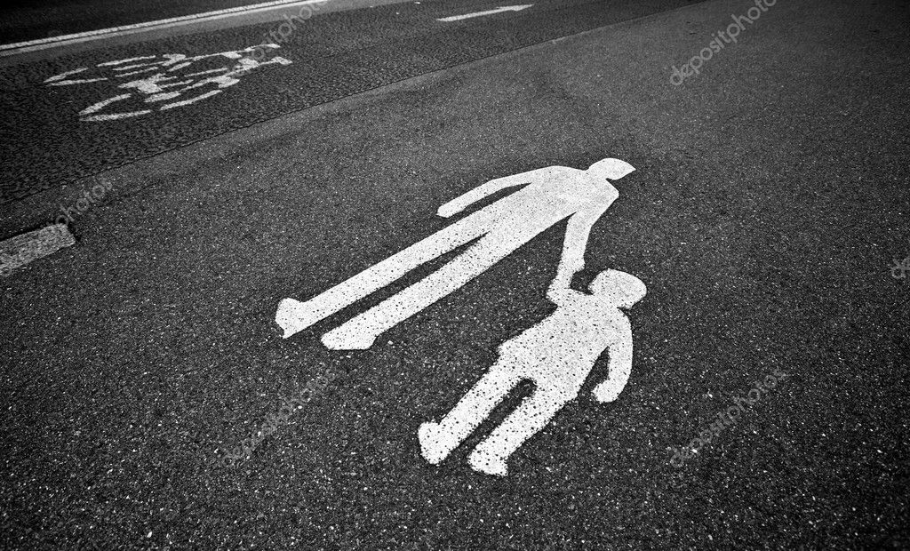 Parental guidance concept - pedestrian sign on the  pavement/sidewalk — Stock Photo #7417599