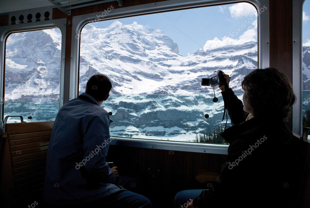 Tourists staring at a glacier in high alps in Switzerland — Stock Photo #7418152