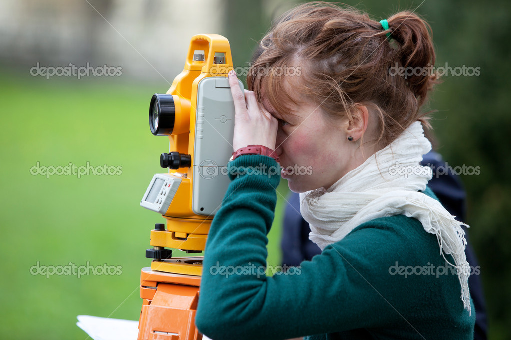 Young land surveyor at work — Stock Photo #7418193