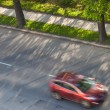 Speeding concept - Cars moving fast on a road on a lovely sunny — Stock Photo #7420009
