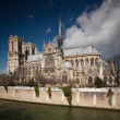 The Notre dame de Paris church side view - Stok fotoğraf
