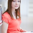Pretty female college student in a library — Stock Photo #7420024