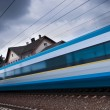 Fast train passing by (motion blur is used to convey movement) — Stock Photo #7420139