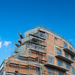 Residential building construction site on a lovely summer day (c - Stock Photo