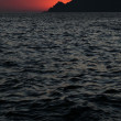 Sunset over Scandola, Corsica, France - Stock Photo