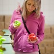 Beautiful young woman shopping for fruits and vegetables — Stock Photo #7421166