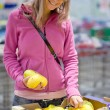 Beautiful young woman shopping for fruits and vegetables — Stock Photo #7421235