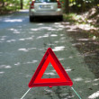 Broken down car with warning triangle - Stock Photo