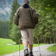 Active handsome senior man nordic walking outdoors - 图库照片