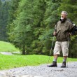 Active handsome senior man nordic walking outdoors — Stock Photo #7422055