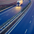 Highway traffic - motion blurred truck on a highway — Stok fotoğraf