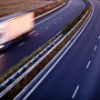 Highway traffic - motion blurred truck on a highway - Stock Photo