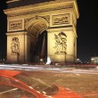 Twilight view of the Arc de Triomphe (Arch of Triumph) - Stock Photo