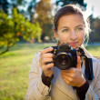 Pretty female photographer outdoors on a lovely day — Stock Photo #7422303