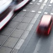 City street with a crossing, rail, motion blurred - Stockfoto