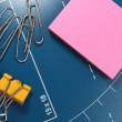 Office stationery - paper clips and post-it pink note paper - Stock Photo