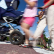 Mother with small children and a pram crossing a street — Stock Photo #7422875