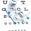 Optometry concept - sight measuring spectacles &amp; eye chart - Foto Stock
