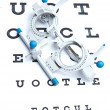 Optometry concept - sight measuring spectacles & eye chart - Stockfoto